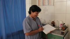 Latin Medical Exam Intake , Smiling Female Doctor Talking to Patient - stock footage