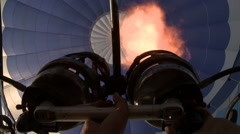 Balloonist sets fire to burner of hot air balloon Stock Footage