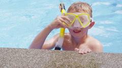 Portrait of boy in pool with snorkel gear - stock footage