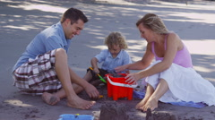 Family making sandcastle together, Costa Rica Stock Footage