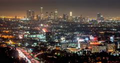 Los Angeles downtown skyline buildings highway time-lapse night Stock Footage