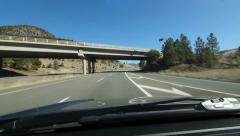 Driving on the Coquihalla Hwy in Merritt, BC, Canada. Passing under bridge. - stock footage