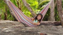 Young girl playing in hammock, Costa Rica Stock Footage