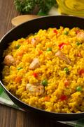frying pan full of rice on wood - stock photo