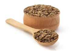Cumin seeds in bowl on white background Stock Photos