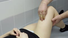 Doctor treats a patient before surgery knee - stock footage
