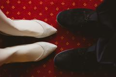 Bride's and groom's shoes on carpet Stock Photos