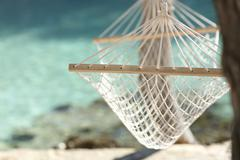Tropical beach vacation concept with a hammock and turquoise water Kuvituskuvat