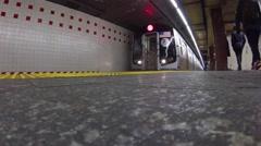 NY subway train departs Penn Station Stock Footage