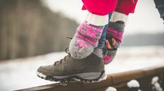 Girl tying shoe laces - stock photo
