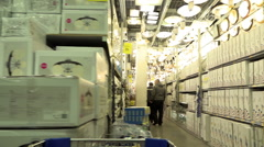 Overview of several rows with the goods in a large grocery store Stock Footage