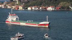 Cargo ship and pleasure boats at Bosphorus Sea Stock Footage