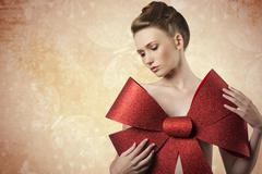 Lovely girl with christmas bow Stock Photos