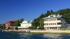 Bosphorus tour boat cruising along Vanikoy coast in Istanbul, Turkey Stock Footage