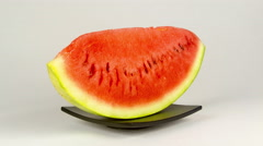 Watermelon slice rotation on a white background, 4K Stock Footage