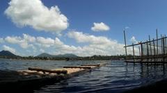 Bamboo Raft beside bamboo poles - stock footage