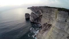 Flight and takeoff over Bonifacio bay area at sunset. Aerial panoramic view. Stock Footage