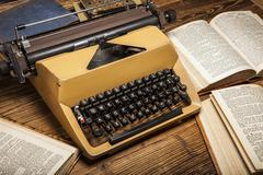 Old typewriter, a pile of books and a lot of creativity Stock Photos