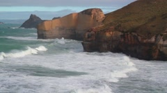 Waves break on Cliff near Dunedin, New Zealand Stock Footage