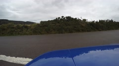 4K blue car is pulling out on a lonely road in the countryside Stock Footage