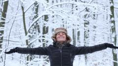 The young girl catches snowflakes, slow motion HD Stock Footage