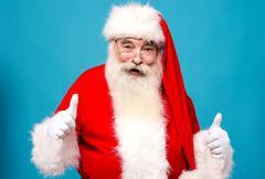 Happy santa claus gesturing thumbsup Kuvituskuvat