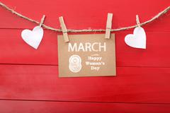 Womans day message with felt hearts hanging with clothespins Stock Photos