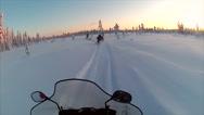 Stock Video Footage of Sweden Lapland Sarkimukka, POV tourists on snowmobile 011
