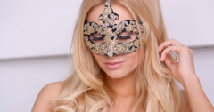 Stock Video Footage of Gorgeous Topless Blond Woman in Carnival Mask