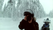 Stock Video Footage of Sweden Lapland Sarkimukka, Tourist on snowscooters, woman takes picture 003