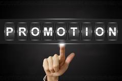 Business hand clicking promotion on Flipboard Kuvituskuvat