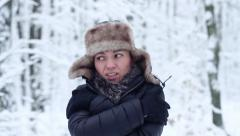 Young woman in winter clothes trying to warm up HD Stock Footage