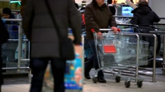 Russia, moscow, 12 february, 2015. People with Shopping cart go shopping on Stock Footage