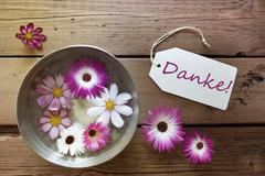 Silver Bowl With Cosmea Blossoms With German Text Danke Stock Photos
