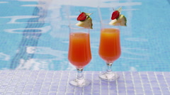 Two cocktails by pool - stock footage