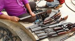 Guns with Land Mafia Stock Footage
