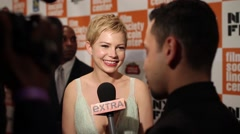 Michelle Williams on the red carpet with actor Eddie Redmayne - stock footage