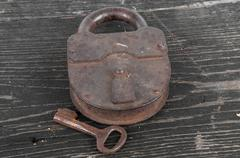 old lock with a key - stock photo