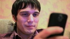 Young man looking at his cellphone. HD. 1920x1080 Stock Footage