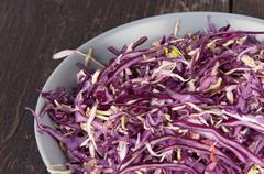 a salad of red cabbage in a bowl - stock photo