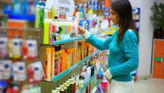 young girl customer doing  shopping in the drugstore. HD. 1920x1080 - stock footage