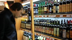 RUSSIA, 14 FEBRUARY 2015, man choosing products in alcoholic during weekly Stock Footage