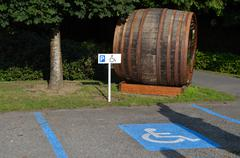 parking for handicapped with large wine barrel - stock photo