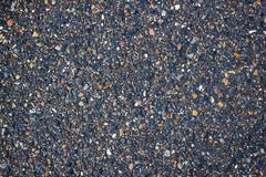 Useful background of wet asphalt texture. - stock photo