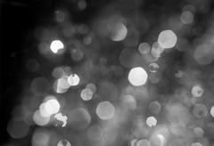 Snow falling dark winter night. Abstract snowflakes background blur. Kuvituskuvat