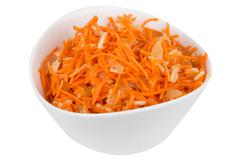 Grated carrot with pineapple in a white bowl Stock Photos