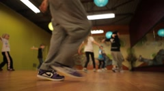 Children dance and jump in exercise class Stock Footage