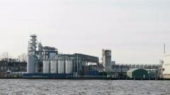 Industrial plant on waterfront Stock Footage