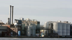 Industrial plant by water Stock Footage