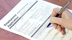 Person filling an employment application Stock Footage